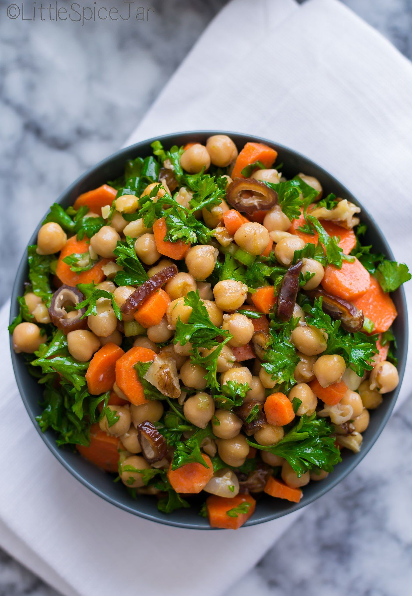 Moroccan carrot chickpea salad with only a few ingredients. Moroccan carrot chickpea salad take s only a few minutes to make and has a honey lemon dressing!