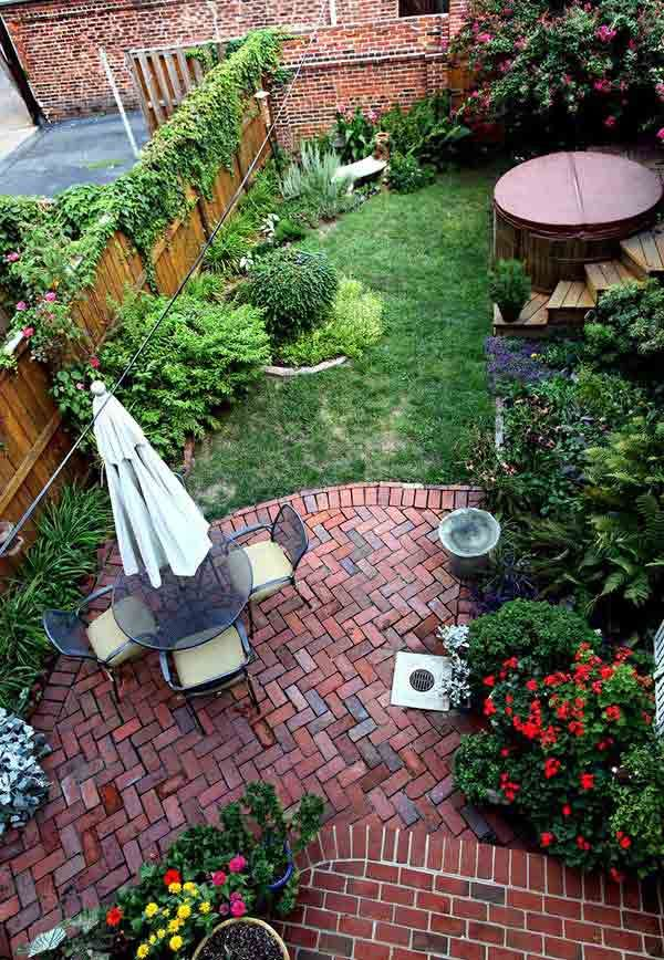 small backyard brick patio addition lots of colorful plantings hot tub w wood deck