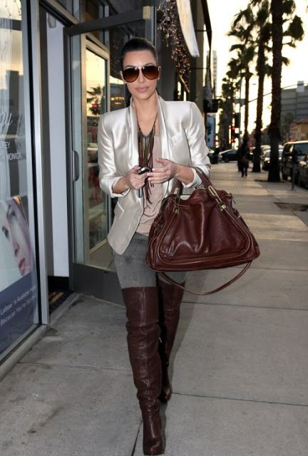 e6b3c28824f5 Kim Kardashian ran errands in slouchy chocolate over-the-knee Fairfax  boots. The boots perfectly matched her cognac Chloe bag.