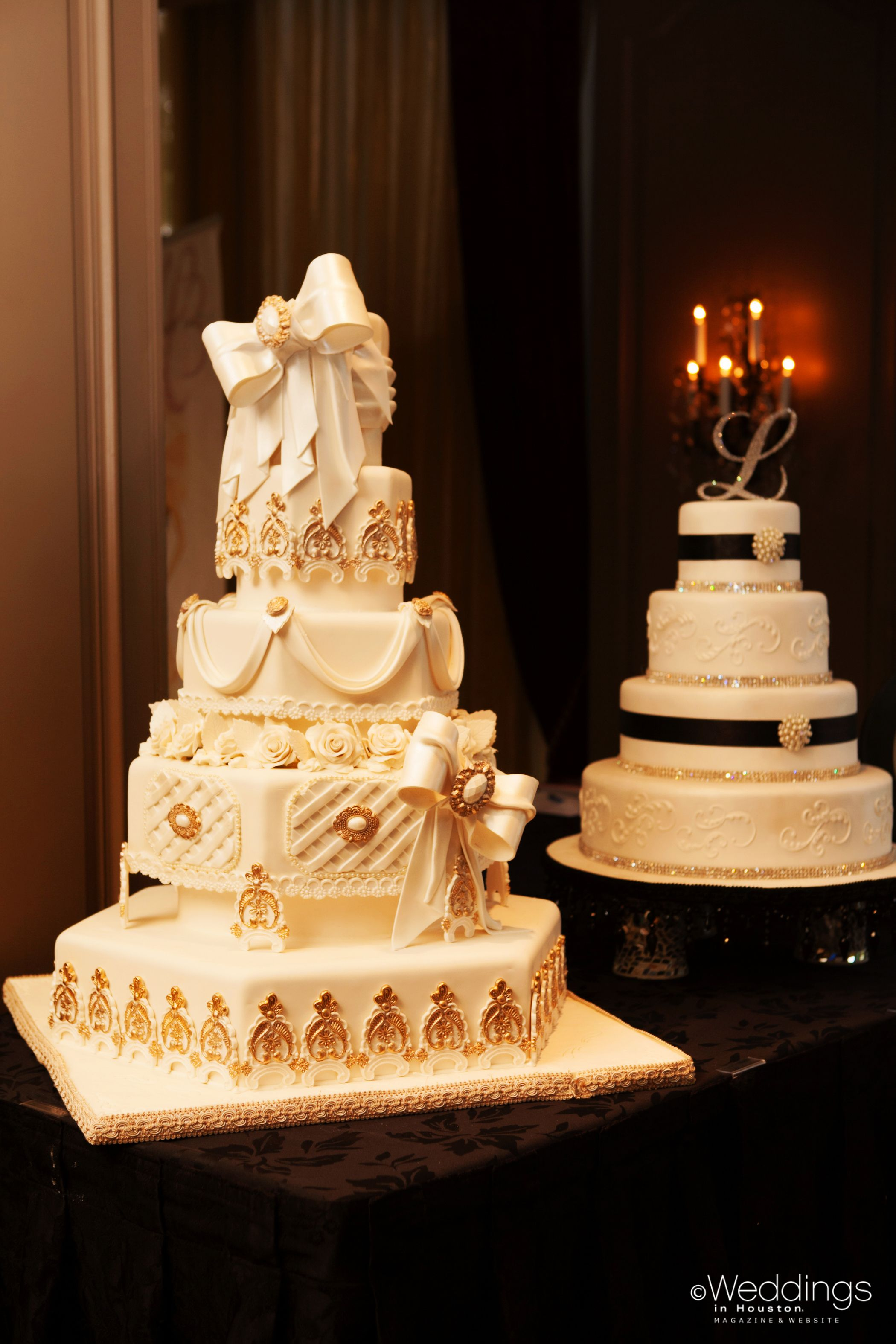 Five tiered ivory wedding cake accented with hints of gold and bows