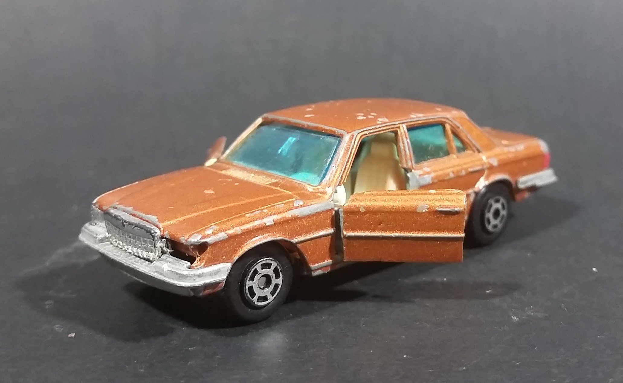 1980s Yatming Brown Bronze Mercedes 450 SL w/ Opening Doors Diecast Toy Car No. 1061 https://treasurevalleyantiques.com/products/1980s-yatming-brown-bronze-mercedes-450-sl-w-opening-doors-diecast-toy-car-no-1061 #Vintage #1980s #80s #Eighties #Yatming #HongKong #Brown #Bronze #Mercedes #450SL #OpeningDoors #Diecast #Toys #Cars #Vehicles #Autos #Collectibles #Automobiles #Luxury