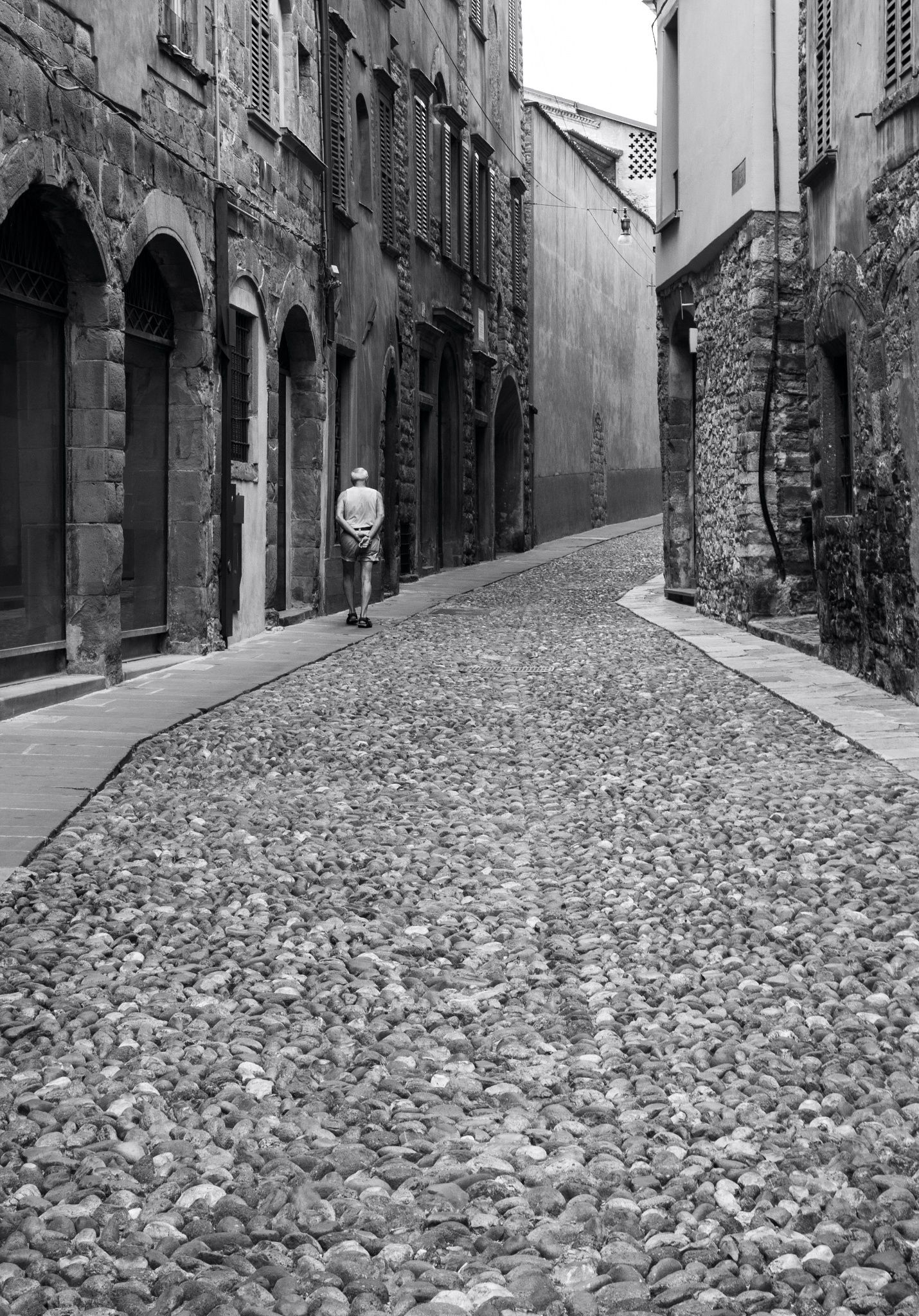Walking on the street in the old city of Bergamo