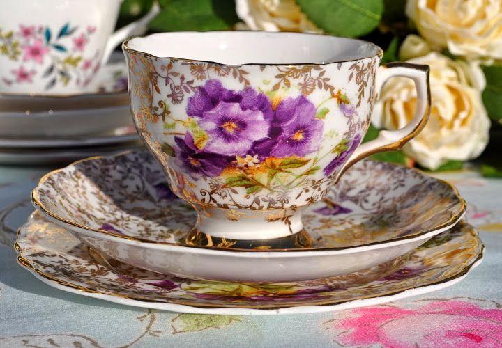 purple pansies and gold vintage china teacup trio