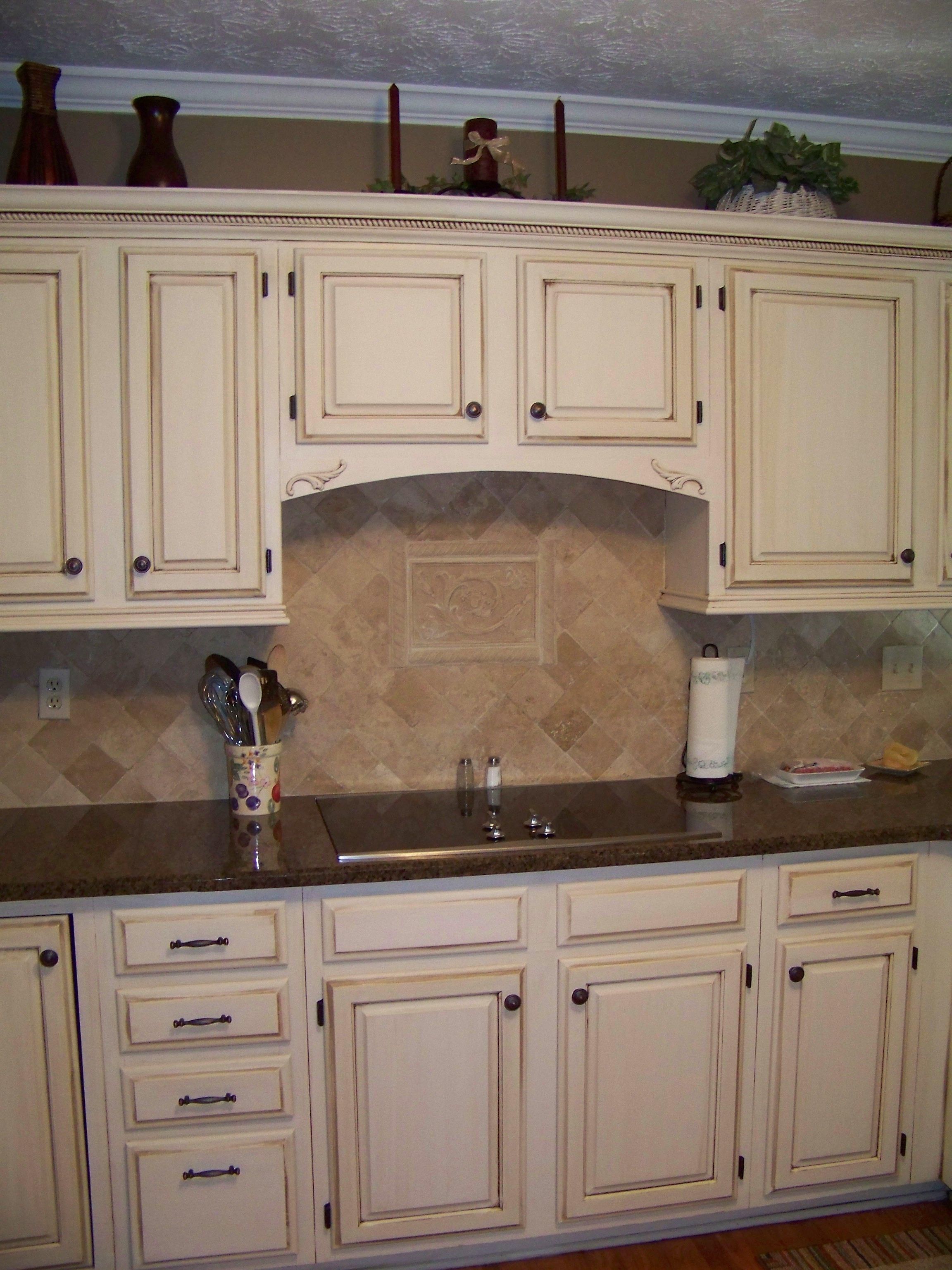 Cream cabinets with dark brown glaze upper cabinets cabinet