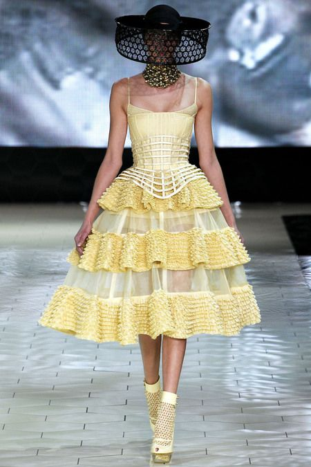 Alexander McQueen, S/S 13, Paris - its all about bees - think about a honey-based color palette, plus the patterning possibilities of comb, plus the frisson of the bee sting, plus the salient fact that Burton is an expectant mother.