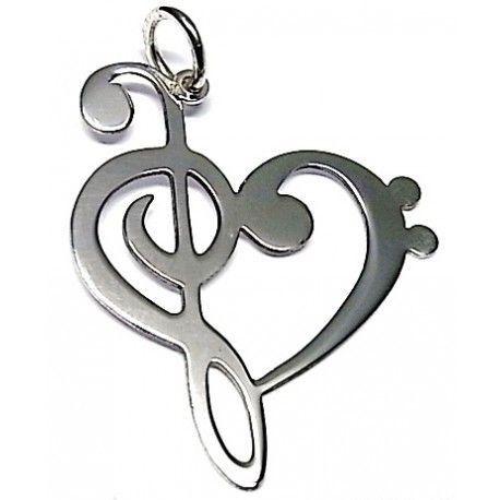 1acf015dd76c Colgante de plata de primera ley con forma de corazón formado por una clave  de sol y una clave de fa. Dimensiones  3