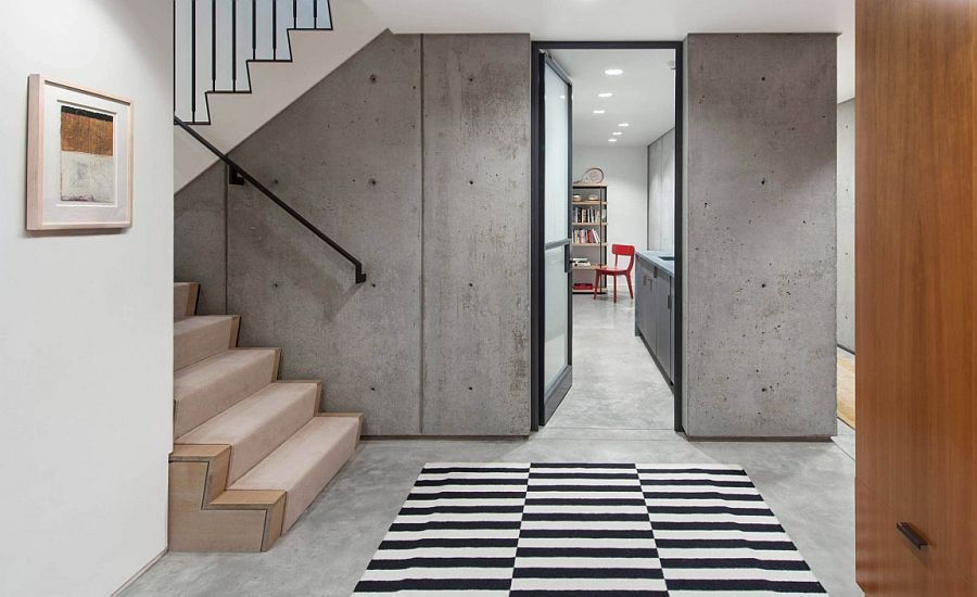 Exposed Concrete Walls Give The Interior An Edgy Modern Look Contemporary House Design Interior Architecture Cambridge House