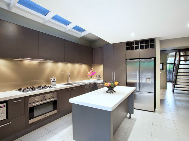 Galley kitchen in dark shades efficiency with galley for Kitchen ideas pinterest