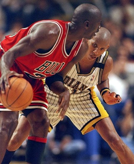 Reggie keeps a close eye on the ball while defending Michael Jordan.