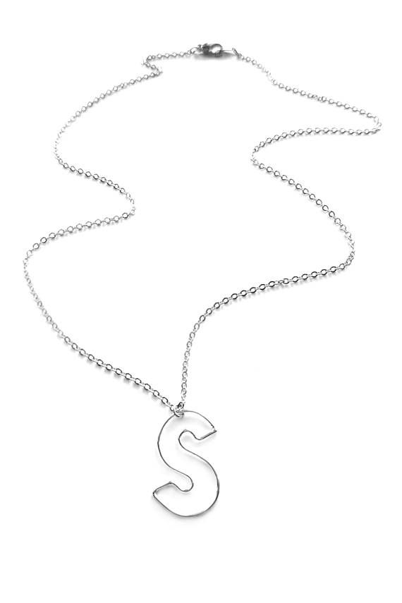 Lightweight delicate statement necklace with a block letter of - statement letter