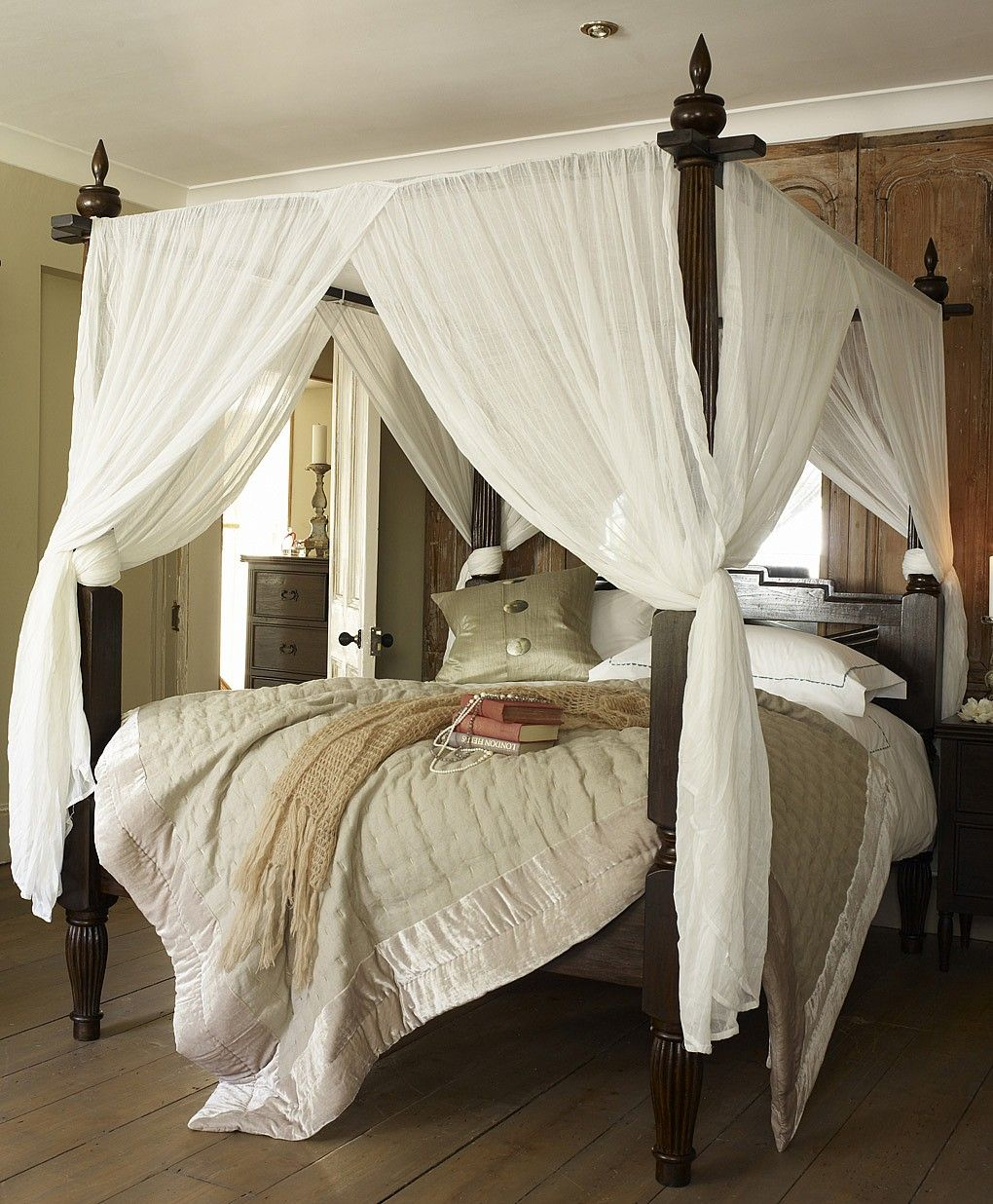 Modern canopy bed curtains - Sewn One Piece Canopy Curtains Crossed Slightly And Gathered Tied Back By Wrapping
