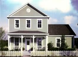 cozy hosue with a white picket fence<3