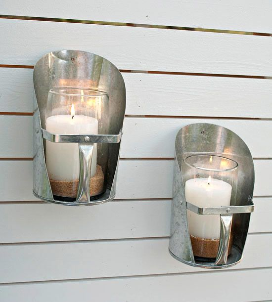 "These ""candle holders"" are heavy-gauge feed scoops from a farm-supply store"