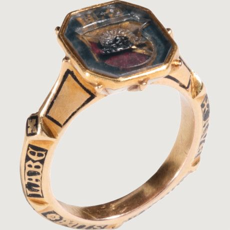MEDIEVAL ARMORIAL SIGNET RING, WITH LOMBARDIC INSCRIPTION. Germany, late 14th century. Gold and crystal.