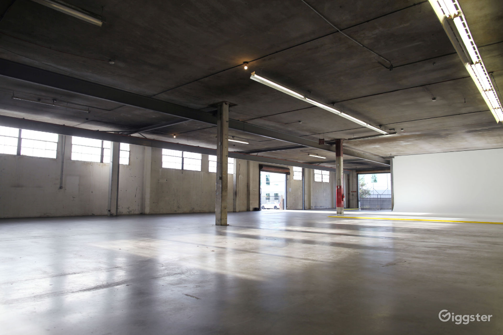 Industrial Warehouse With Cyclorama Rent This Location On Giggster Industrial Warehouse Industrial Backyard Office
