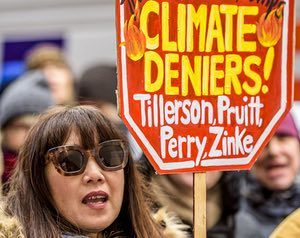A protest in New York against climate change skeptics in Donald Trump's cabinet.