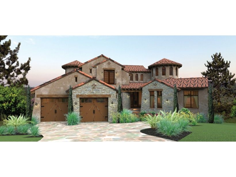 twin turrets rustic stone and warm stucco grace this tuscan inspired home - Home Designs Grace Collection