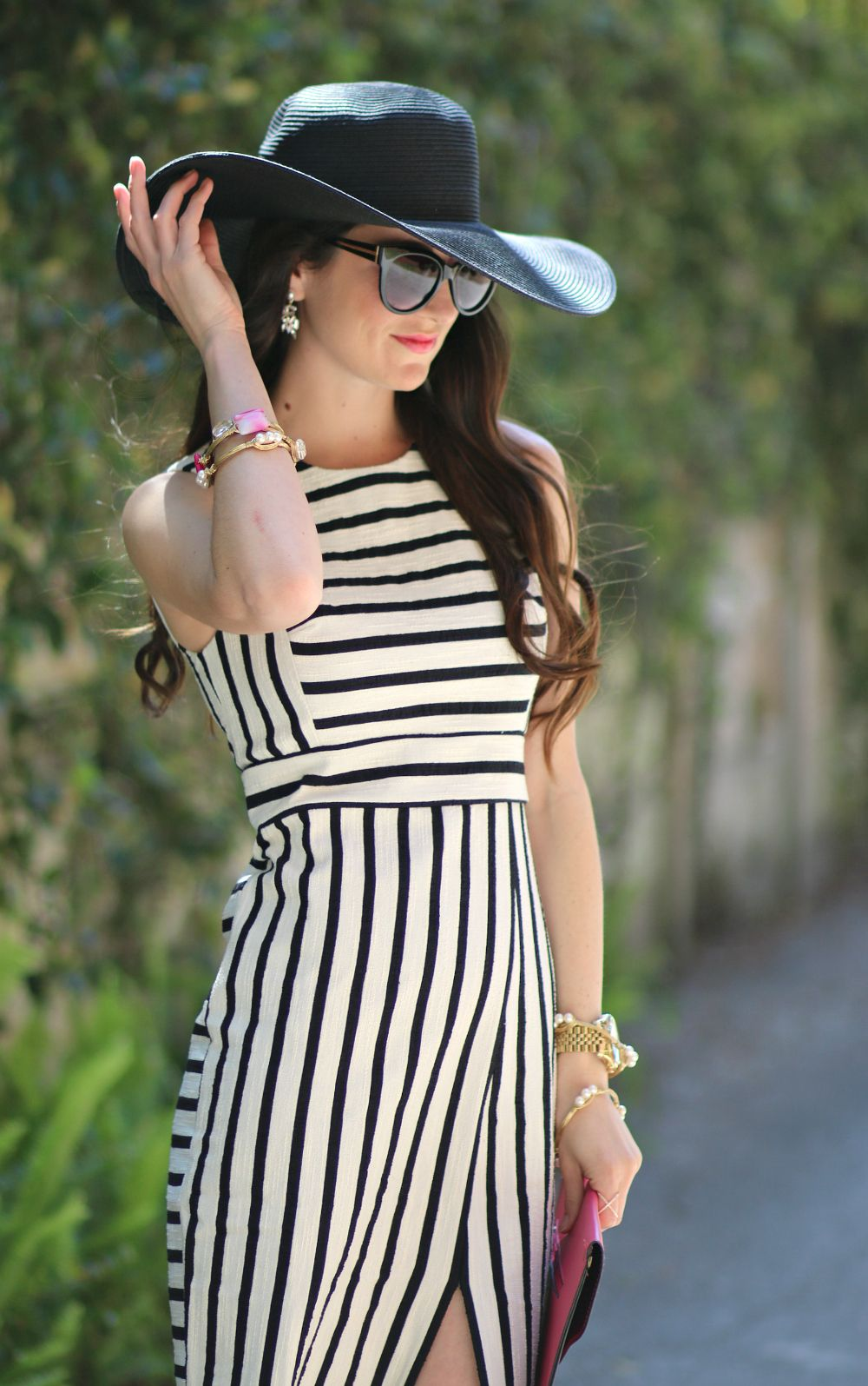 a5373ef36a A classic and understated Derby Day-inspired look. Love the black and white  stripes paired with hot pink accessories.