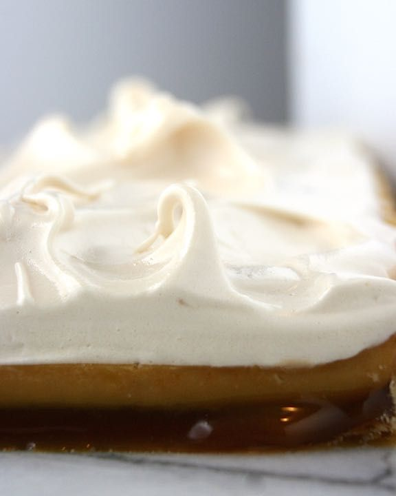 CLOUD NINE – Flaky homemade pie dough layered with vanilla bean caramel sauce, butterscotch custard, and smooth peaks of brown sugar meringue.
