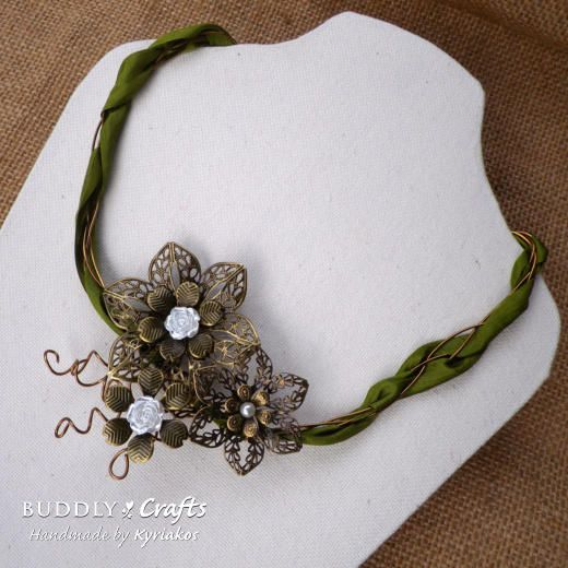 Make an elegant vintage looking necklace using filigree metal flowers, wire and silk ribbon. The colour of the ribbon can be changed to match your style.