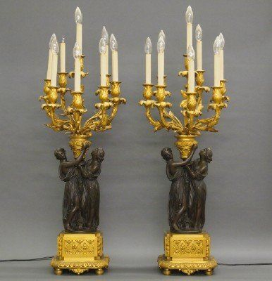 Pair of 19th Century French Bronze candelabra. Classical Greek Danaides support Louis XV style 8-branch gilded candelabra on squared bases with foliate bosses, swags and moldings. Original Gilded and Dark Brown patina with slight wear, electrified.