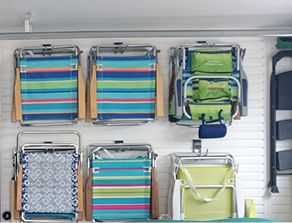 Garage storage solutions - slat wall with beach chair storage hooks installed by NEAT Storage Designs & Garage storage solutions - slat wall with beach chair storage hooks ...