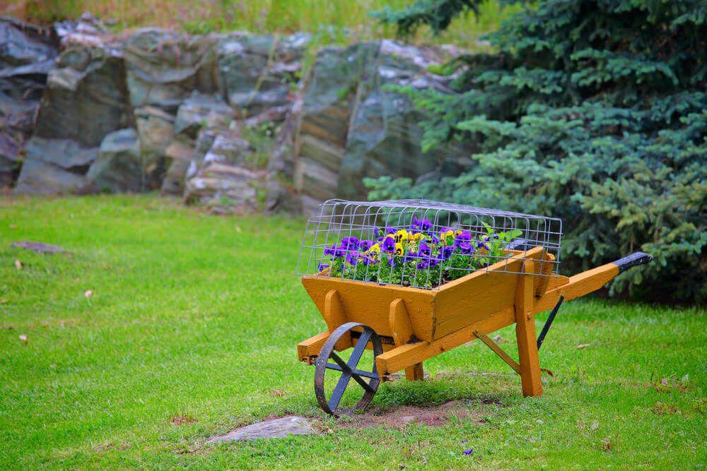 27 Wheelbarrow Flower Planter Ideas For Your Yard