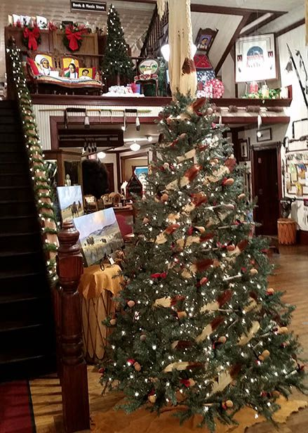 We Have A Very Simple Native Style Tree And Then Add Lights To The Bannister To Enhance The Wal Simple Christmas Decor Native American Store Simple Christmas