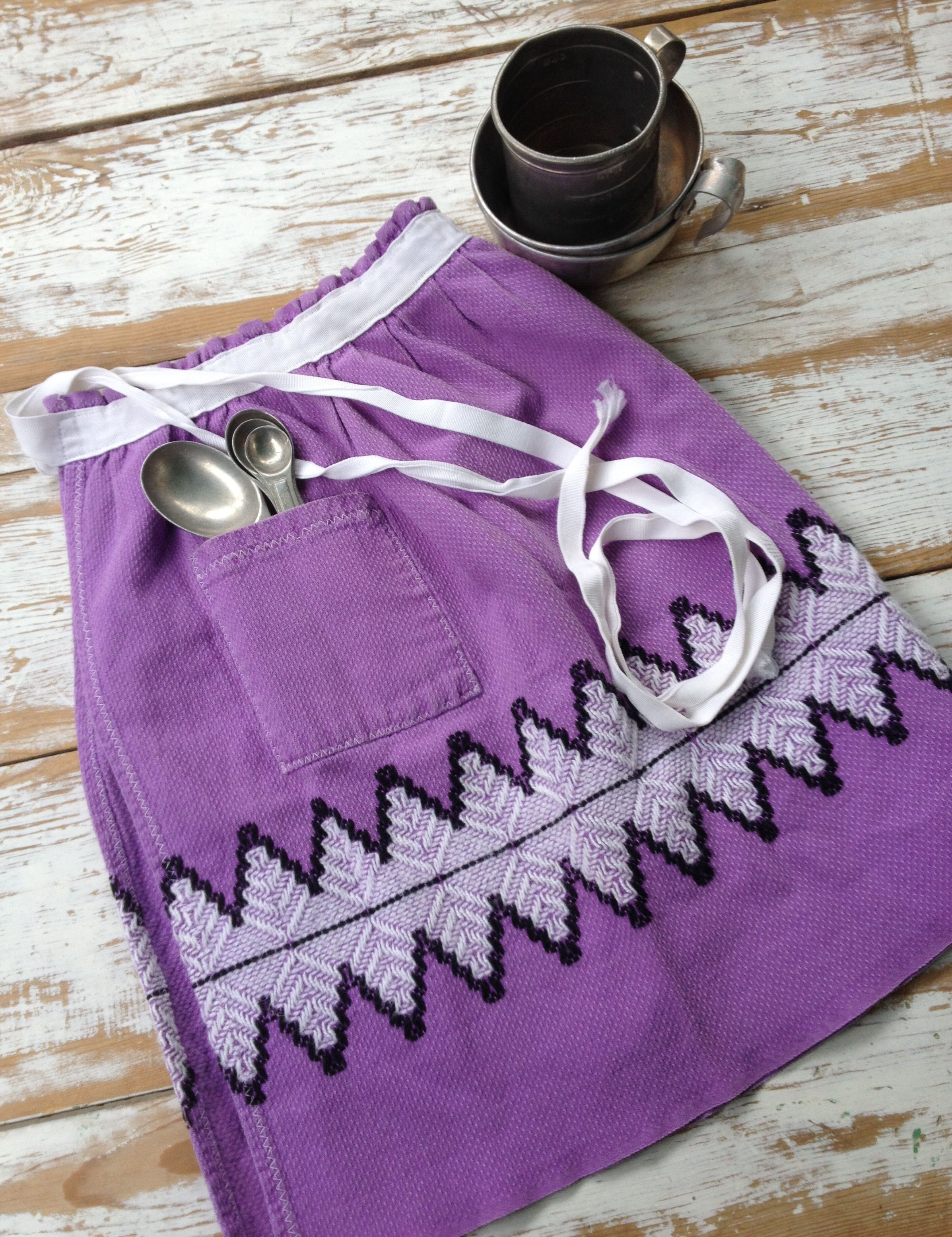 Vintage purple with white and black embroidery half apron .