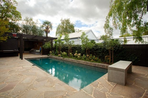 Example Of Feature Wall With Planting Behind To Pool Edge