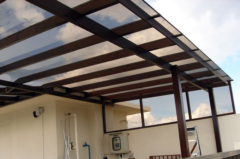 Polycarbonate patio or deck roof. Let's light in, protects from rain. Modern design ...