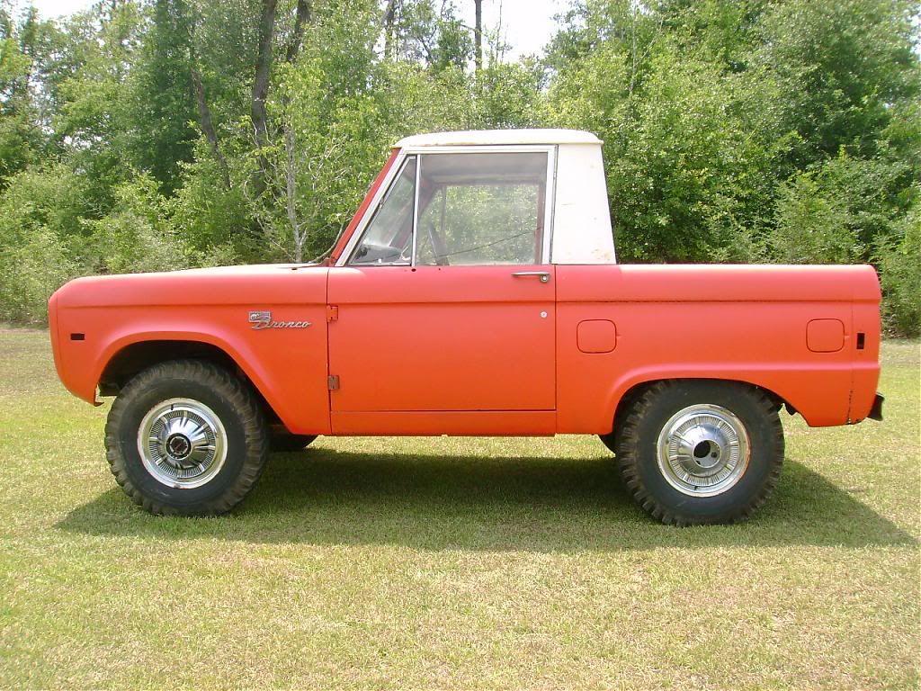 Orange And White 1966 Ford Bronco Half Cab