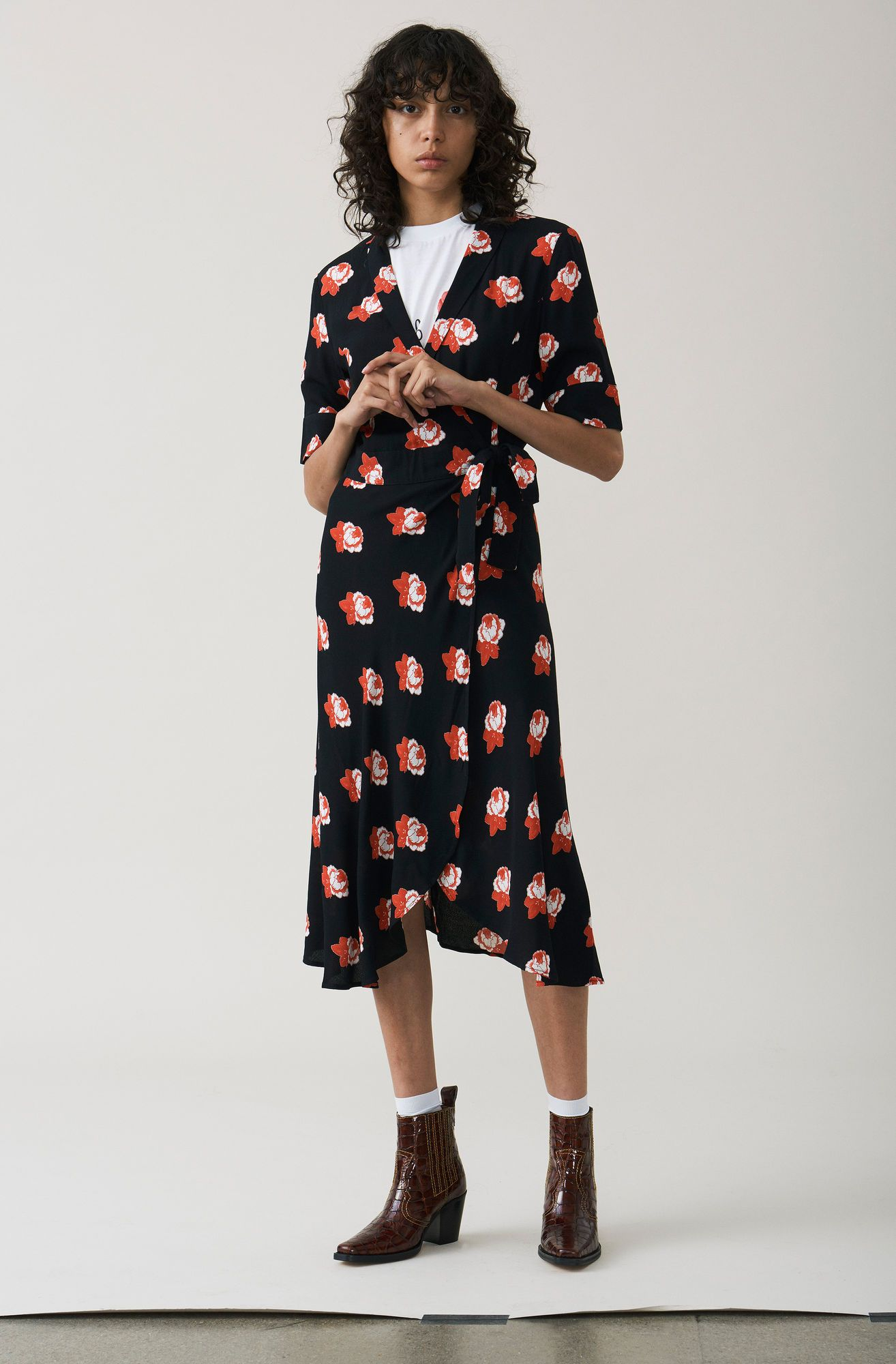 da844caffd58 Flattering wrap dress with a tea dress cut and roomy t-shirt sleeves  finished with a concealed waist belt and delicate frill details.