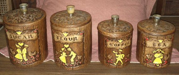 Vintage 1960s Set Of Treasure Craft Pottery Brown Ceramic Kitchen Canisters - Flour, Coffee, Tea, Sugar With Dutch Boy and Girl via Etsy
