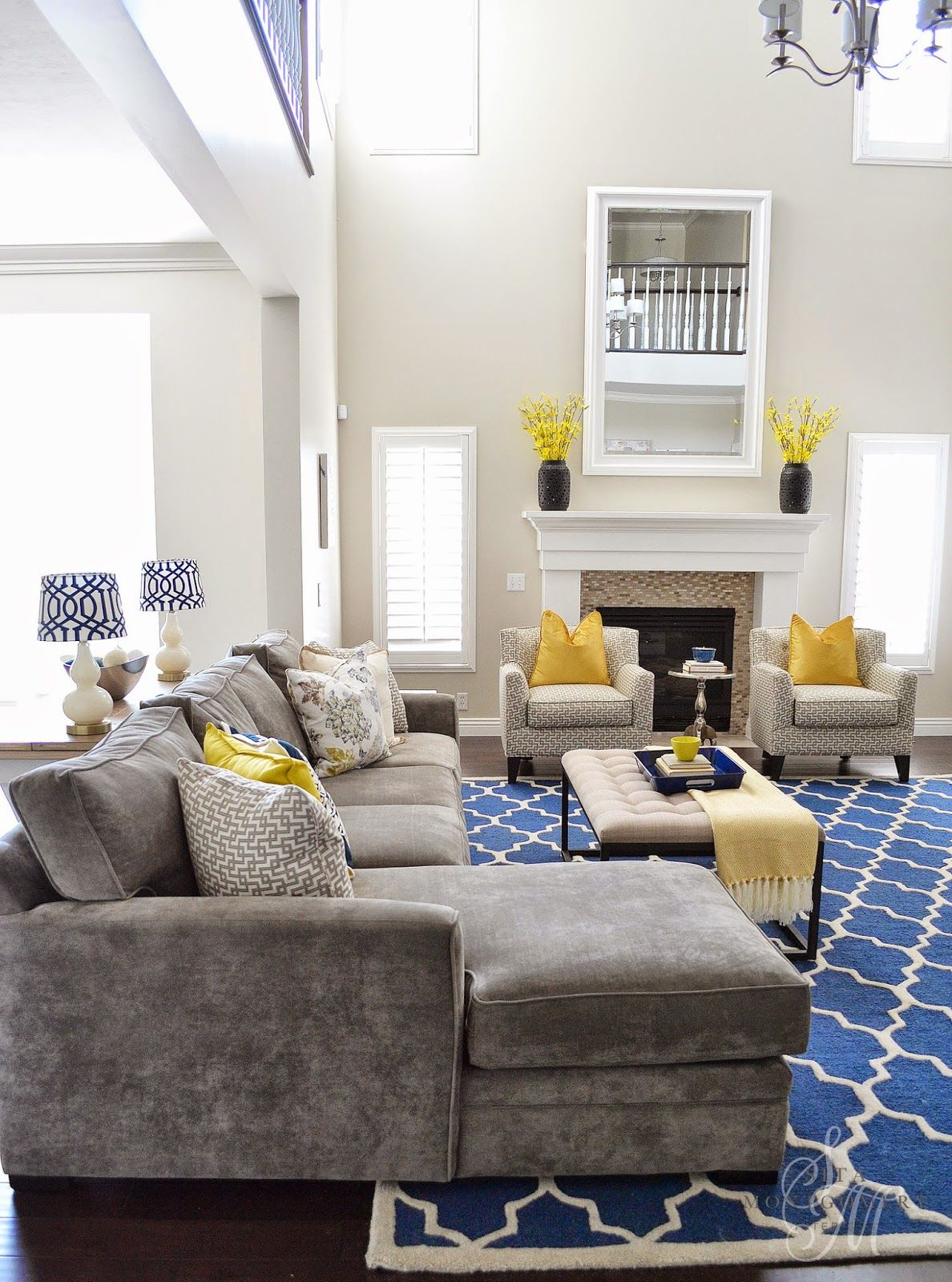 I love this grey sectional blue rug and yellow accents if we ever put hardwood in the great room i want this rug we already have yellow walls and ive