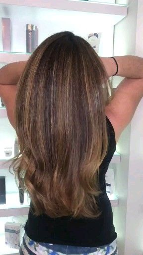 Laura's favorite brunette! Base color, highlights and a cut with round brush blowout