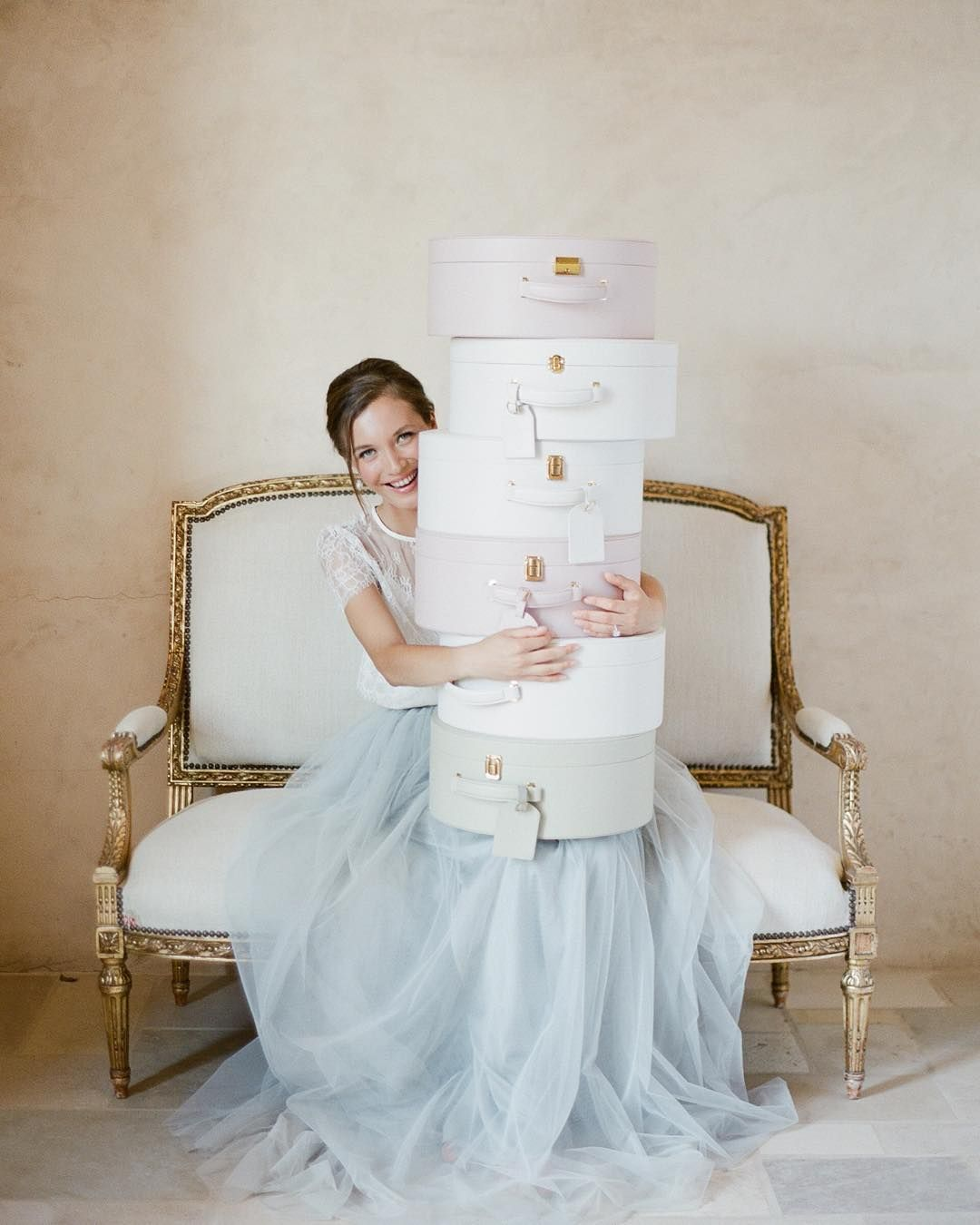 Your wedding essentials should be organized and protected. The monogrammed hatboxes from @trousseauandco are designed with enough space for heels makeup toiletries jewels undergarments and all the rest of your precious heirlooms. For updates and to sign up for our waitlist visit our website: http://ift.tt/1LFvD6L Photo by @josevilla gown @alexandragrecco sofa @foundrentals hair and makeup @teamhairandmakeup #trousseauandco #monogrammedhatbox by joyproctor