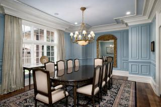 Dining room with beautiful blue grey color on walls and gorgeous trim for ceiling mouldings