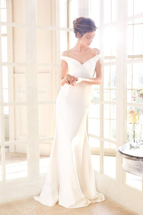 Ivory crepe trumpet bridal gown, off