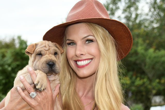 Beth Ostrosky Stern poses with rescue dog Mei Ling
