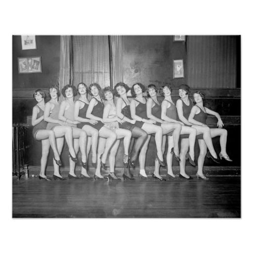 A chorus line of girls show some leg in this portrait. Circa 1925.