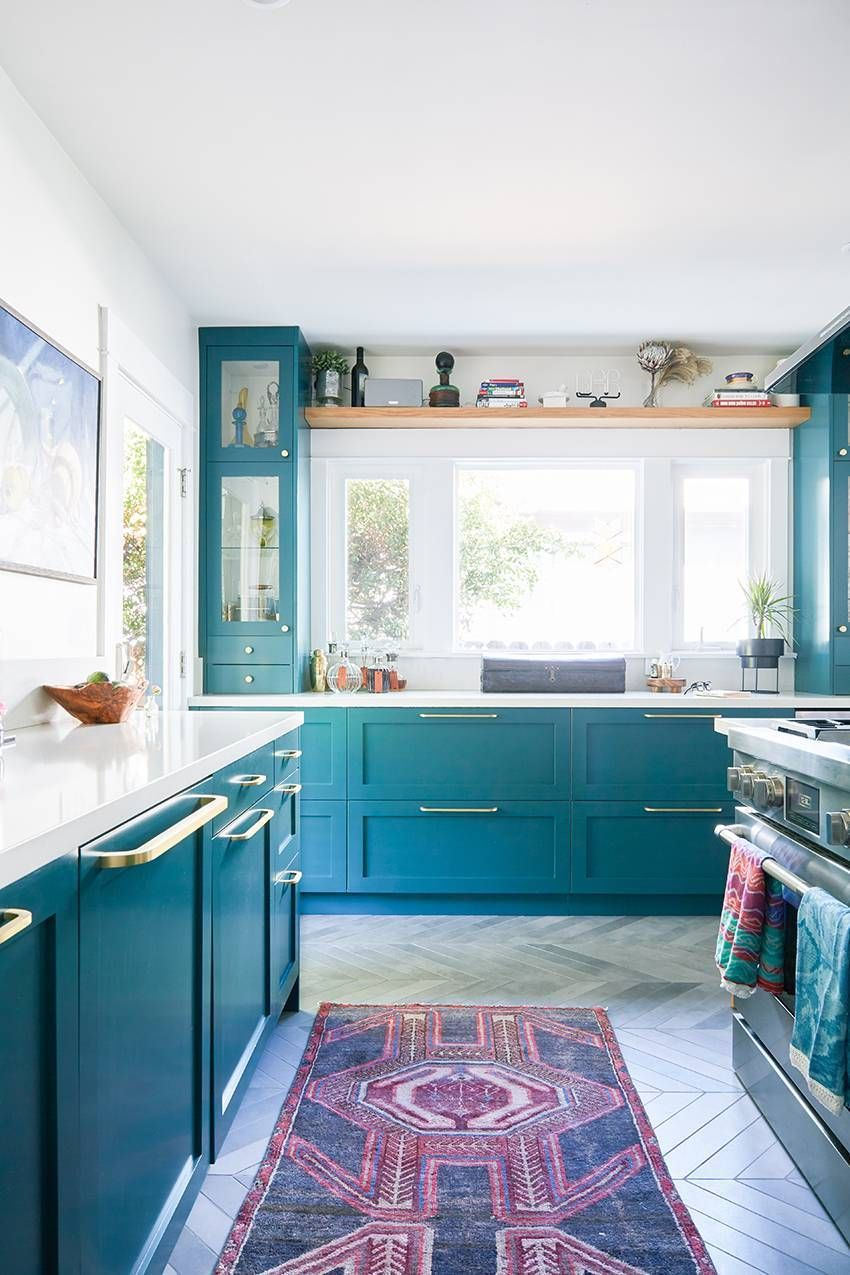eclectic blue bungalow  teal kitchen cabinets interior