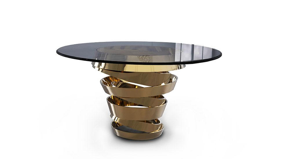 Intuition metal and glass Dining Table by Koket. The two tone metal ribbon of this beautiful round dining table evokes the mysterious and divine feminine instinct. The base is in Matt black metal with a touch of gold powder inside. Smoked glass crowns this modern dining table.