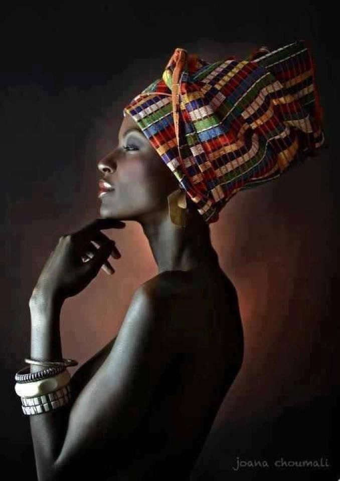Beautiful dark skinned African female in  gorgeous colorful striped head wrap.