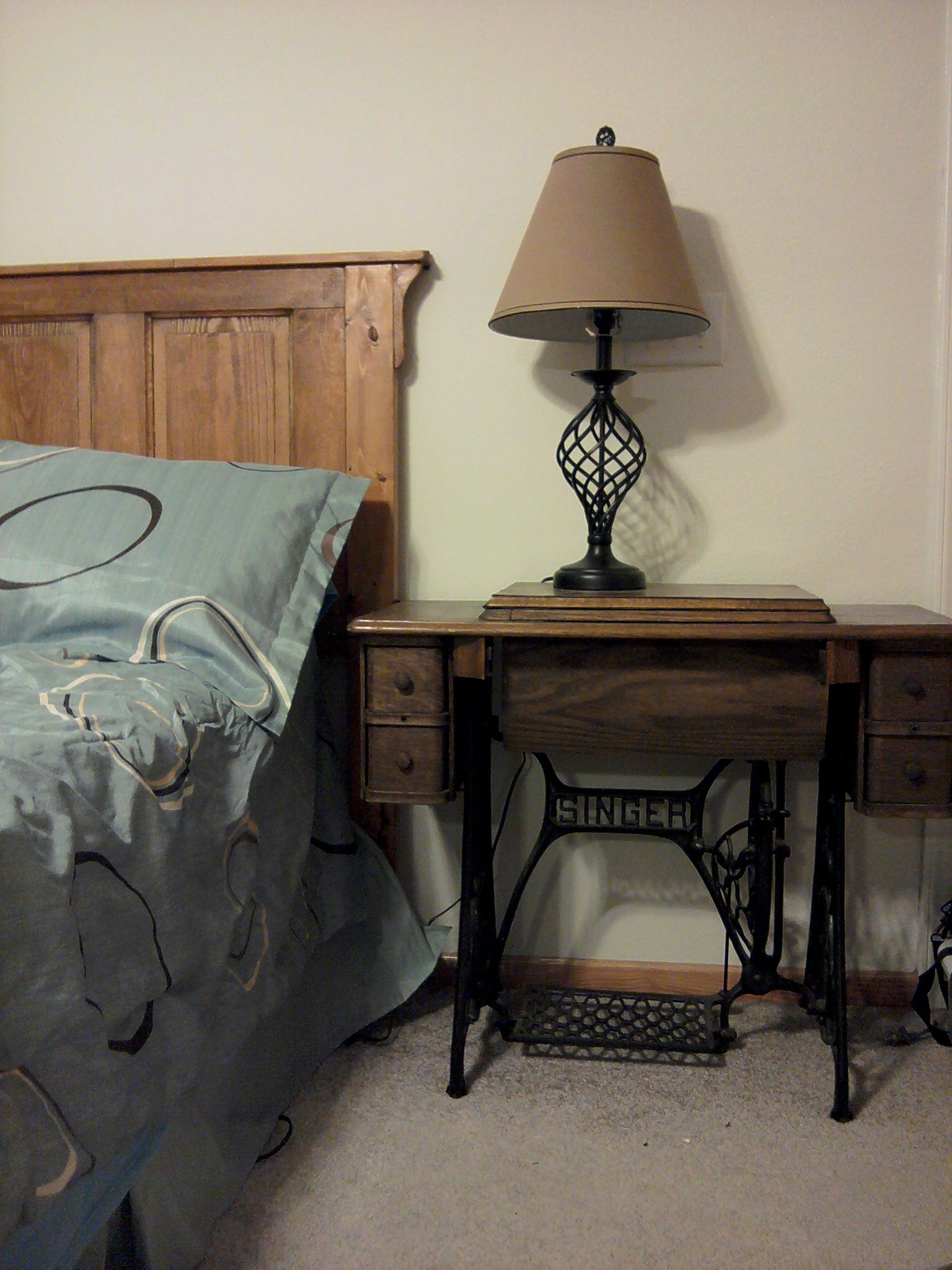 antique sewing table for bedside and antique panel door for headboard