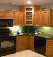 Corner Wall Cabinet With Glass Door Raised Panel Arch Door Style Hickory Kitchen Cabinets Traditional Kitchen Cabinets Kitchen Cabinet Design