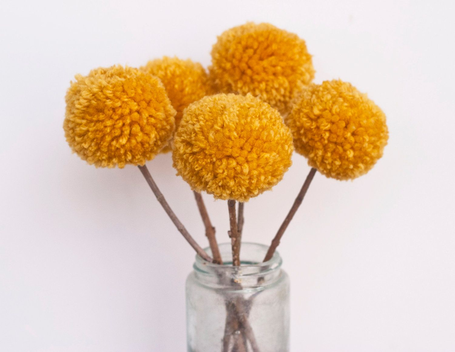Cute table decor homemade pom pom flowers with yarn sticks and cute table decor homemade pom pom flowers with yarn sticks and hot glue olur wedding color is yellow mightylinksfo