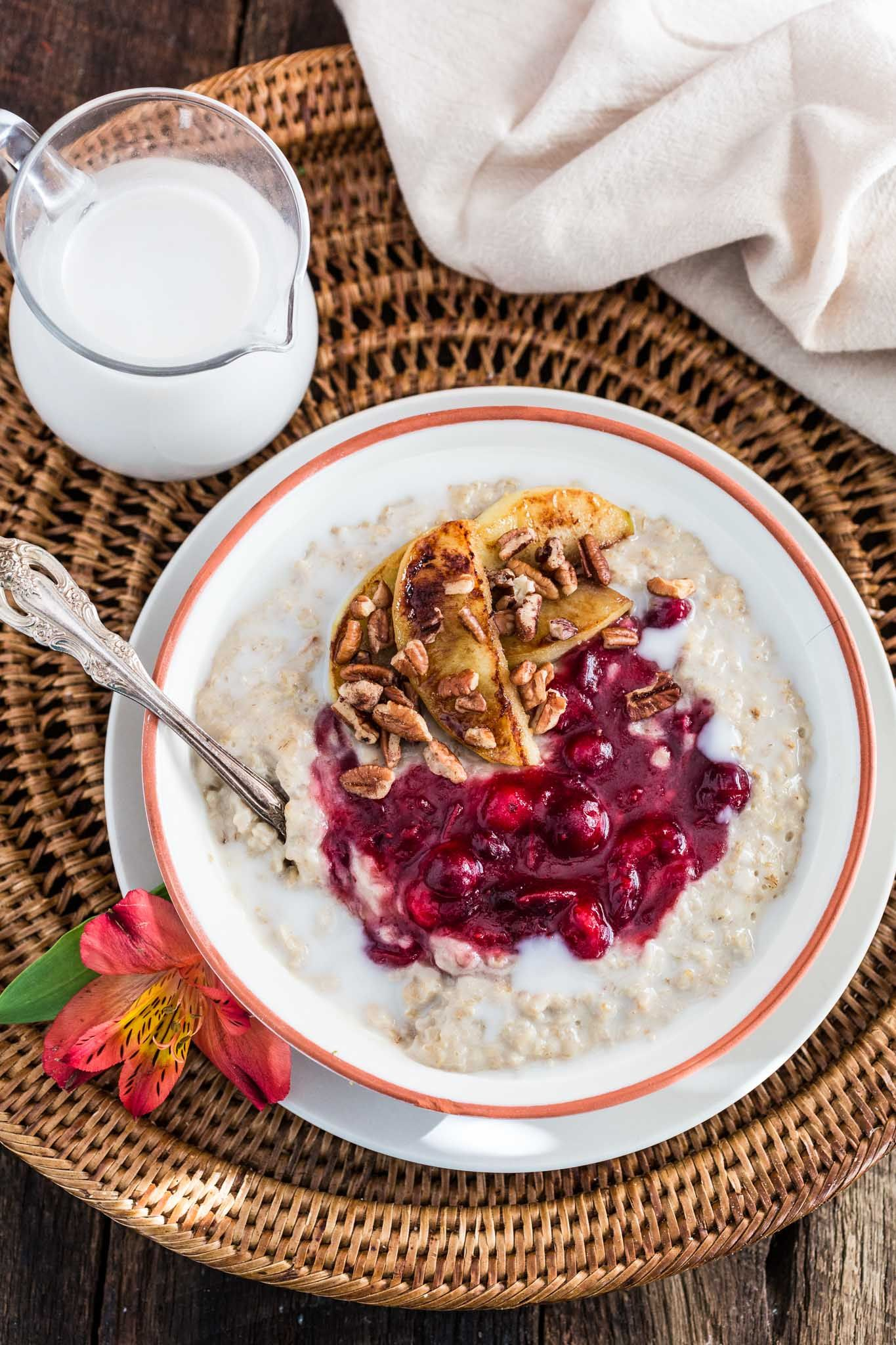 Christmas Oats Porridge with Cranberry Sauce, Apples and Pecans | www.oliviascuisine.com | Waking up to a special breakfast on Christmas morning is a must! This festive porridge is not only delicious but also heartwarming. Sweet, tart, creamy and crunchy goodness. What else could we wish for?: