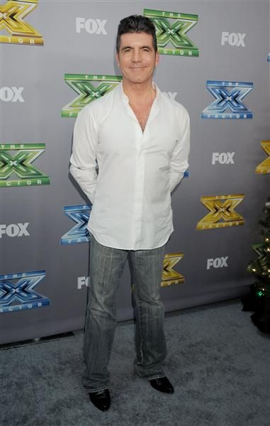 """Simon Cowell attends FOX's """"The X Factor"""" season finale at CBS Televison City in Los Angeles on Dec. 19, 2013."""