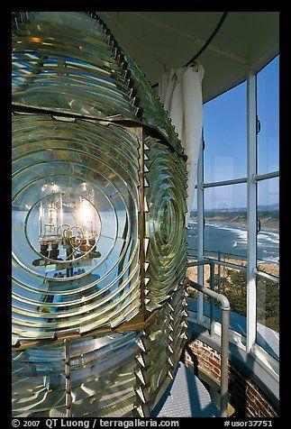 Rotating light inside Cape Blanco Lighthouse tower and landscape. Oregon, USA
